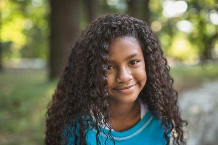 tweens: Smiling girl standing outdoors