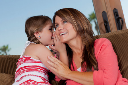 tilting: Girl whispering in mother?s ear