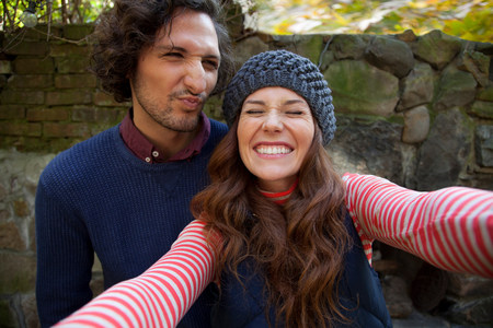 silliness: Couple taking picture together outdoors