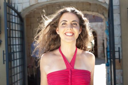 assured: Smiling woman walking outdoors