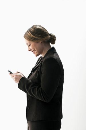 file clerk: Businesswoman texting on smartphone