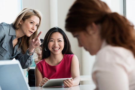 access point: Businesswomen talking in office