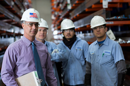 50 54 years: Workers and businessman in metal plant LANG_EVOIMAGES