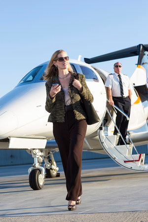 Businesswoman on airplane runway