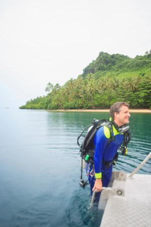 Scuba diver climbing into water LANG_EVOIMAGES