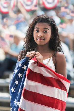 Girl at rally wrapped in american flag
