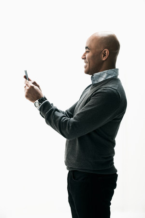 30 years old man: Businessman texting on smartphone LANG_EVOIMAGES