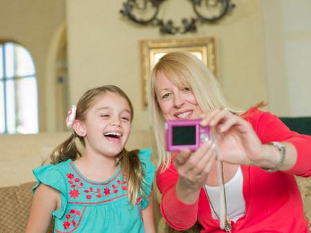 off shoulder: Mother and daughter taking picture LANG_EVOIMAGES