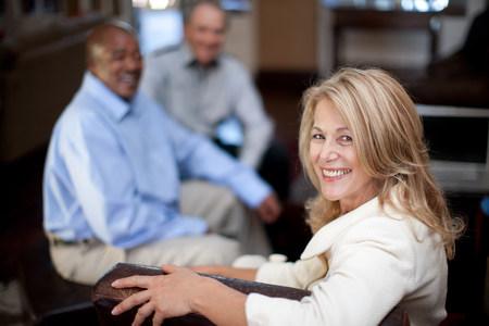 60 64 years: Older woman smiling in armchair
