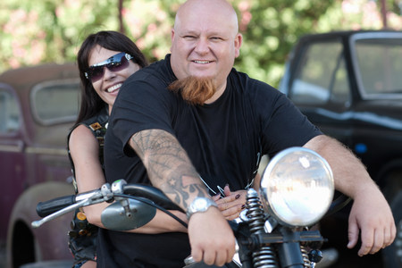 transportation: Couple sitting on motorcycle LANG_EVOIMAGES