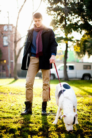 Man walking dog in park LANG_EVOIMAGES