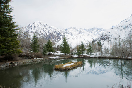 Mountains reflected in still rural lake LANG_EVOIMAGES