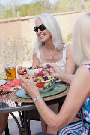 tea breaks: Older women having lunch together
