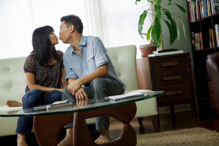 each year: Couple kissing in living room