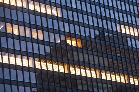 mirroring: Illuminated windows of skyscraper LANG_EVOIMAGES