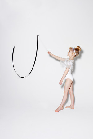 gifted: Girl playing with ribbon streamers