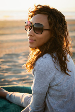 Smiling woman in sunglasses on beach