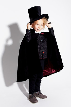 Boy wearing magician costume LANG_EVOIMAGES