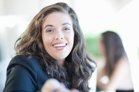 assured: Close up of businesswoman smiling