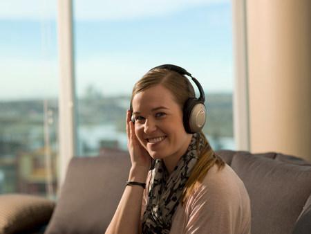 Smiling woman listening to headphones