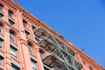 Fire escape on apartment building LANG_EVOIMAGES