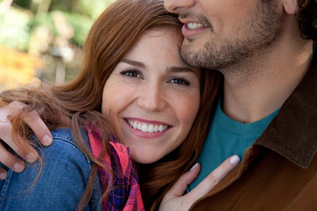 25 29 years: Smiling couple hugging outdoors