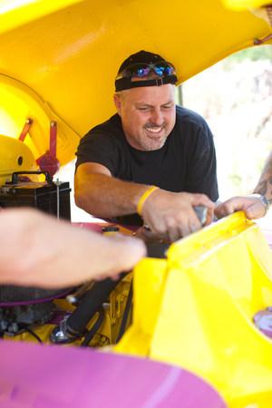 age 25 30 years: Mechanics working on colorful car