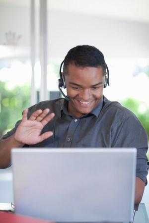 Businessman wearing headset at desk