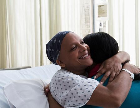 recuperating: Daughter hugging mother at hospital LANG_EVOIMAGES