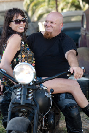 Couple sitting on motorcycle LANG_EVOIMAGES