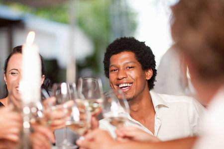 off shoulder: Friends toasting in restaurant