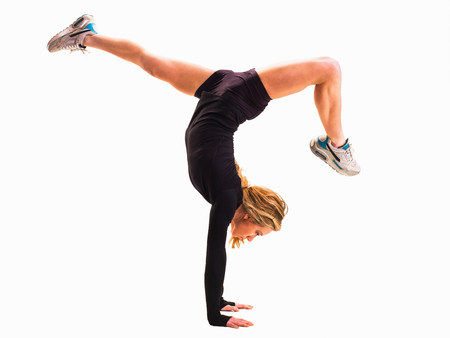 25 29 years: Woman doing handstand