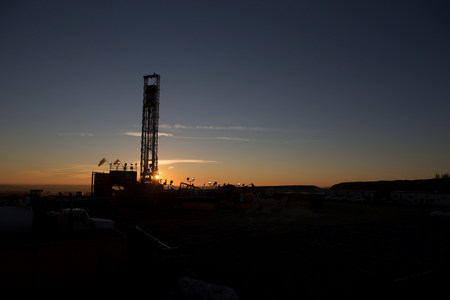 perilous: Silhouette of oil well in dry landscape LANG_EVOIMAGES