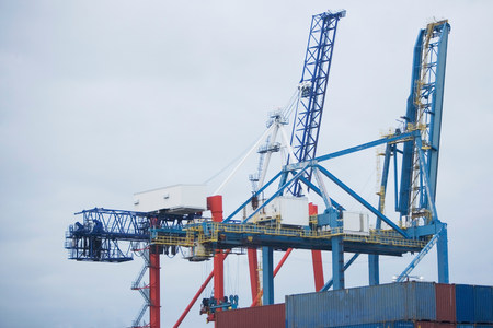 Crane and containers on loading dock