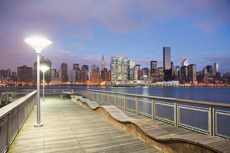 New York City skyline lit up at dusk