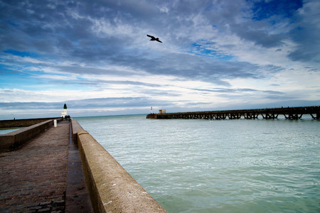 vacant land: Harbor wall and wooden pier