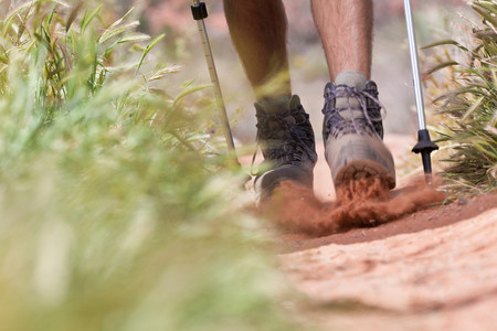 way out: Hiker walking on dirt path