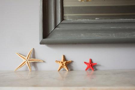 Three starfish on mantelpiece