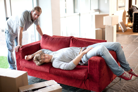 removals: Two removals men,one lying on sofa