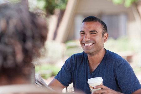 Couple having coffee together outdoors