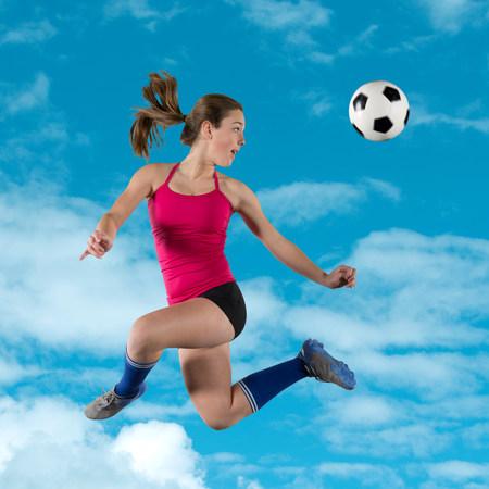 kick around: Soccer player kicking ball in air