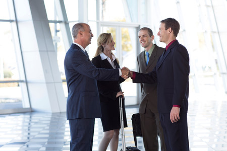 50 54 years: Businesspeople shaking hands