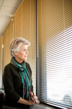60 64 years: Senior woman looking through window