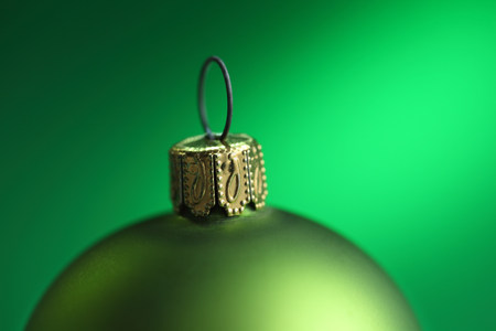 frailty: Close up of green christmas bauble LANG_EVOIMAGES