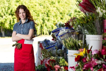 good color: Florist smiling in shop