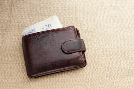 Brown leather wallet with twenty pound note