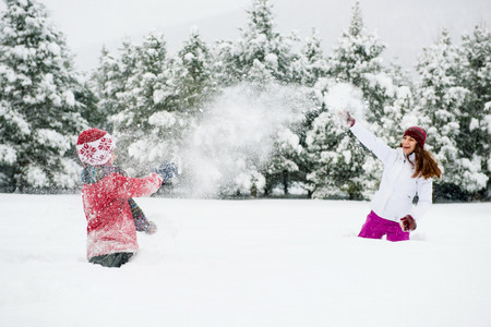 covered fields: Children playing in snow