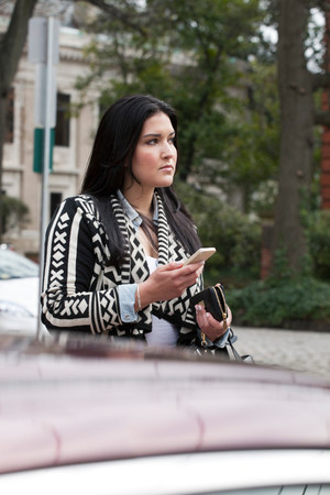 Young woman holding cell phone