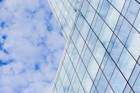negative area: Glass skyscraper and cloudy sky