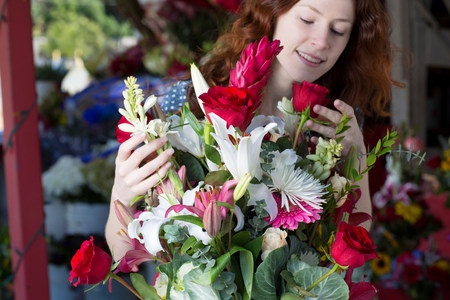 Florist arranging bouquet in shop